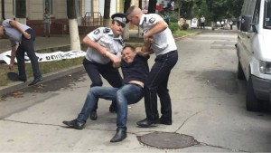 Protest organizer Grigory Petrenko dragged away from oligarch's home by police in Chișinău, Moldova, July 31. Photo: Grenada.md