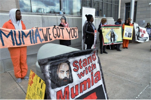 Supporters rally on first day of hearing, Dec 18.WW photo: Joseph Piette