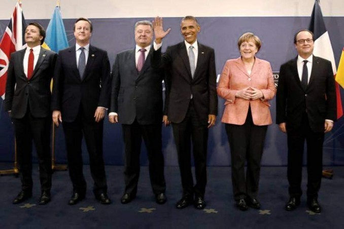 Italy's Prime Minister Matteo Renzi (L-R), Britain's Prime Minister David Cameron, Ukraine's President Petro Poroshenko, U.S. President Barack Obama, Germany's Chancellor Angela Merkel and France's President Francois Hollande stand for a photograph after their meeting.