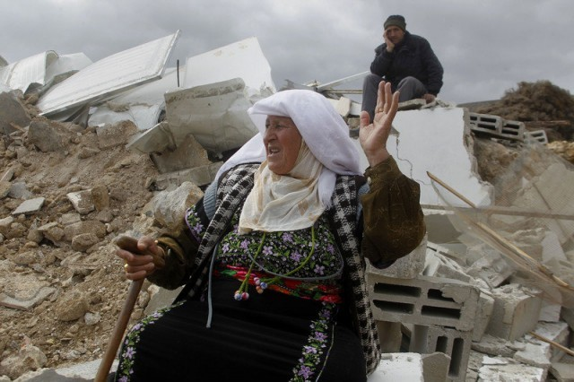 A Palestinian woman in the West Bank after occupation forces destroyed her home, Feb. 2.Photo: Electronic Intifada