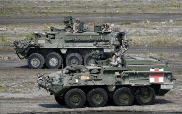 """U.S. soldiers aboard armored vehicles take part during a military exercise with Philippine troops called """"Balikatan"""" (shoulder-to-shoulder) in Capas, Tarlac in northern Philippines April 14, 2016."""