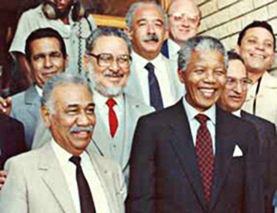 Jorge Risquet Valdés-Saldaña, with beard, behind Nelson Mandela.