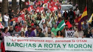 Workers in Spain face bankers' austerity and threat of imperialist war. Above, a 2013 protest of the bases in Morón and Rota.
