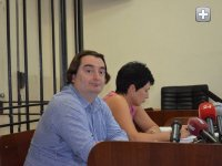 Editor Igor Guzhva, left, on trial.