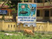 Sign outside a school warns students about unexploded weapons.WW photo: Joyce Chediac