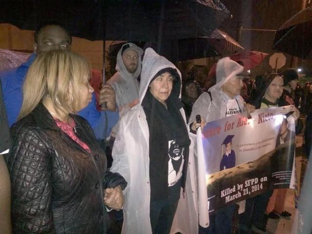 Left, Gwendolyn Woods, Mario Woods' mother, and Elvira Nieto, Alex Nieto's mother, hold hands during Black/Brown unity march.Photo: @4AlexNieto