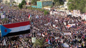 The flag of former South Yemen is seen attached to a billboard during a rally in Yemen's southern port city of Aden October 14, 2014.