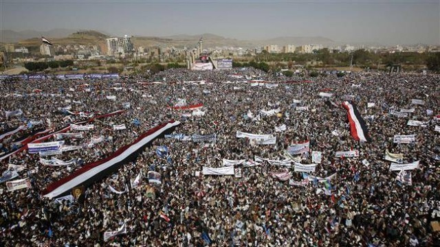 Yemeni people attend a rally marking first anniversary of Saudi Arabia's war of aggression against the country in the capital, Sana'a, March 26.