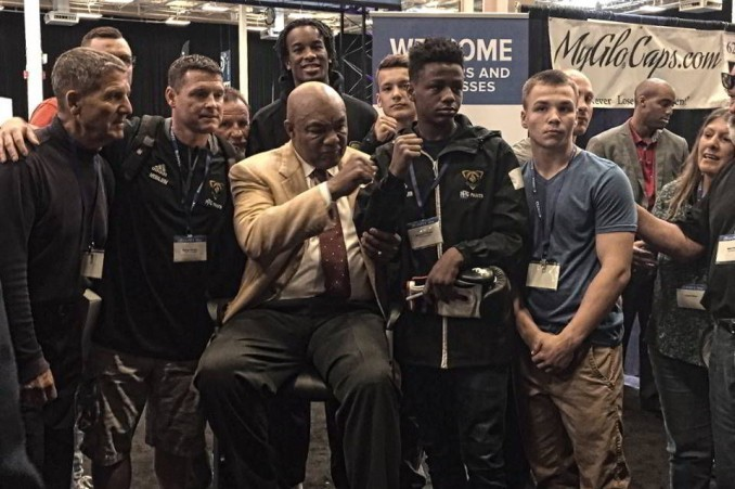 Boxing champ George Foreman with Pittsburgh youths who will box with the Cubans on July 30.